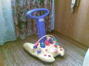 Продам игрушечный тренажер для обучения ходьбы детей от года
